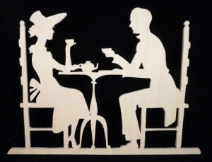 unpainted_couple_sharing_tea_time_victorian_style_wood_display_silhoue_8b1071a3